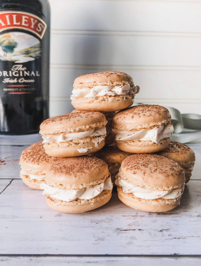 These Bailey's Irish Cream Macarons are crispy and chewy with a creamy Bailey's Buttercream filling. The macarons have espresso powder mixed into the meringue, so the coffee flavor is a nice compliment to the Irish Cream. The Bailey's in the buttercream filling makes it light and airy looking like fresh whipped cream. This macaron recipe makes delightfully crisp cookies that are soft and chewy in the center. #xokatierosario #baileysirishcreammacarons #easymacaronrecipes #irishcreammacarons