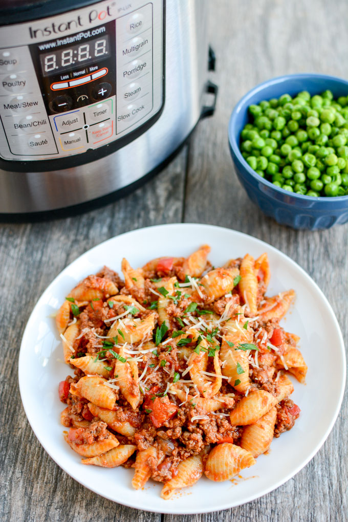 Instant Pot Pasta with Meat Sauce   Learn how to make easy pasta recipes you know and love in a one-pot wonder machine like the instant pot. These instant pot pasta recipes may seem too good to be true. With a little cleanup, you can have delicious soul-satisfying instant pot comfort food meals you can't wait to make. #xokatierosario #instantpotrecipes #instantpotpastarecipes #quickpastarecipes