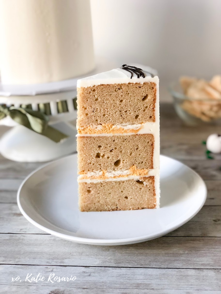 """Learn how to take your pumpkin pie """"cake"""" to the next level. This Pumpkin Pie Cake is a creative spin on the traditional pumpkin pie that you're friends and family will devour! It's made with pumpkin spice cake, no-bake pumpkin cheesecake filling, buttery pie crust, and vanilla buttercream. Here's a fall-inspired cake that will have you craving a Thanksgiving pumpkin pie! #xokatierosario #pumpkinpiecake #pumpkinpatch #fallcakeideas #cakedecoratingtipsandtricks"""