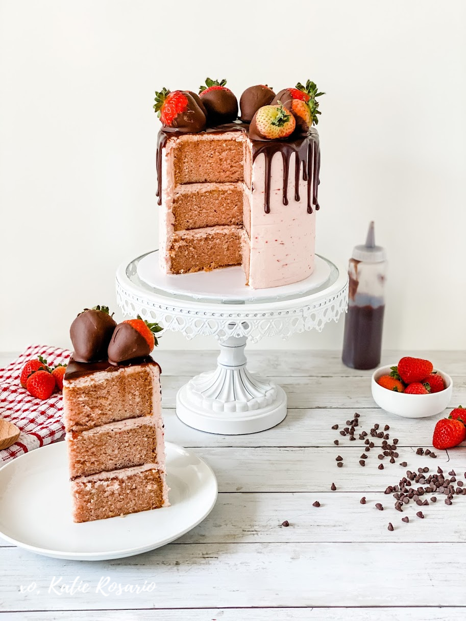 Looking for an easy Valentine's Day cake that'll make the perfect gift? This chocolate covered strawberry cake is insanely delicious and beyond simple for a new baker! Here's how to make this Chocolate Covered Strawberry Cake that's perfect for newbies! #xokatierosario #chocolatestrawberrycake #valentinesdaycake #strawberrycake #chocolatedripcake
