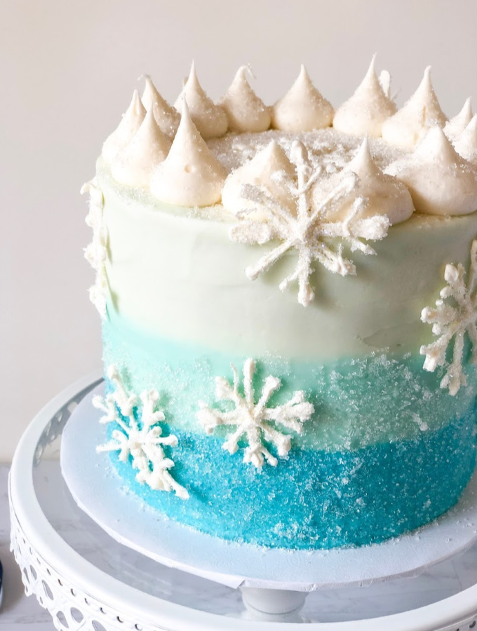 These cold days indoors can be so much sweeter when you can make these winter wonderland cakes. You'll choose from cakes like a blue ombre Snowflake Cake or Nutella Hot Chocolate Cake to Rum Spiked Eggnog Cake or a Sweater Weather Cake for those chilly nights. Here's how to make these 10 Winter Wonderland Cake Ideas That are Instagram Worthy. #xokatierosario #cakedecorating #cakedecoratingtips #wintercakeideas #holidaycakes
